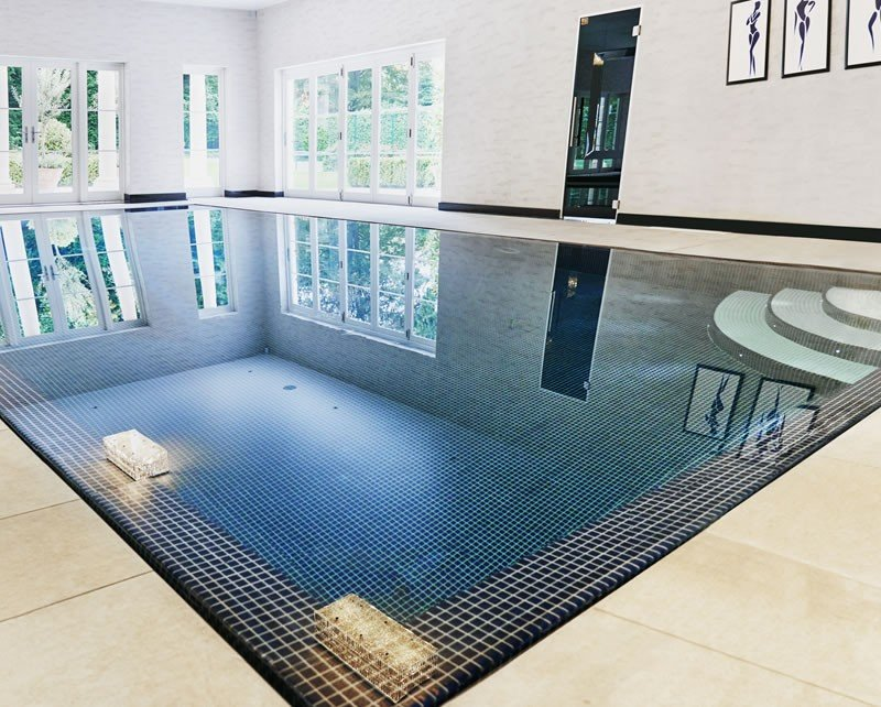 Outdoor indoor swimming pool construction build in oxshott Basement swimming pool construction